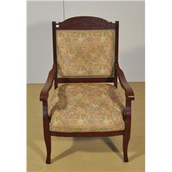 An Arts and Crafts Style Stained Oak Arm Chair.