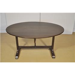 A Gothic Revival Style Oak Tilt-Top Table.