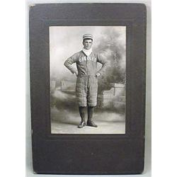 ANTIQUE MOUNTED PHOTO OF BASEBALL PLAYER IN UNIFOR