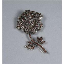 A Sterling Silver Garnet Rose Form Brooch.