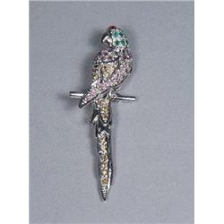 A Silver Garnet, Emerald, Amethyst and Citrine Macaw Form Brooch.