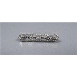 A 14 kt Yellow and White Gold Diamond Bar Pin.