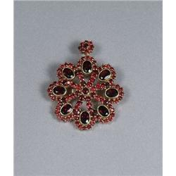 A Sterling Silver and Gold Vermeil Garnet Pendant Brooch.