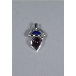 A Sterling Silver and Gold Vermeil Amethyst and Lapis Lazuli Pendant,