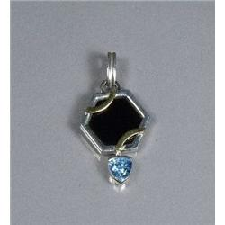 A Sterling Silver and Gold Vermeil Blue Topaz and Onyx Pendant,