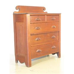 An American Carved Walnut Chest of Drawers,