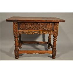 A 17th Century Spanish Carved Walnut Low Table with Drawer,