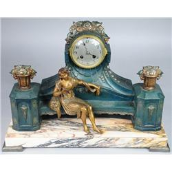 A Patinated White Metal Mantle Clock.