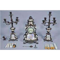 A Louis XV Style Patinated Metal and Porcelain Garniture Set,