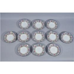 A Set of Eleven Royal Doulton Soup Plates.