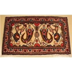 A Persian Sarouk Wool Rug.