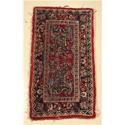 An Antique Persian Sarouk Wool Rug.