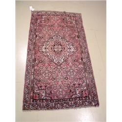 A Persian Malayer Wool Rug.