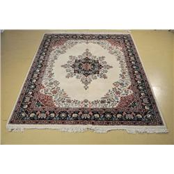 An Indo Persian Kirman Wool Rug.