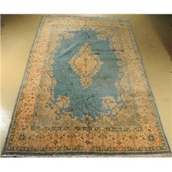 A Persian Kirman Wool Rug.