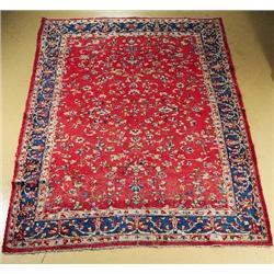 A Persian Kirman Wool Rug.