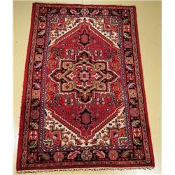 An Indo Persian Heriz Wool Rug.