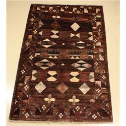 A Pakistani Oushak Wool Rug.