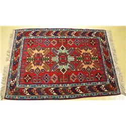 A Pakistani Caucasian Wool Rug.
