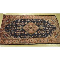 An Antique Turkish Oushak Wool Rug.