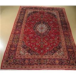 A Persian Kashan Wool Rug.