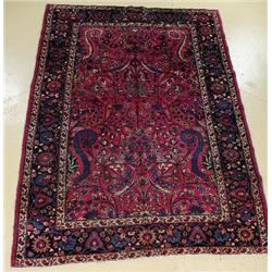 An Antique Persian Mashad Wool Rug.