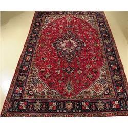 A Persian Tabriz Wool Rug.