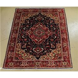 A Persian Colourful Heriz Wool Rug.