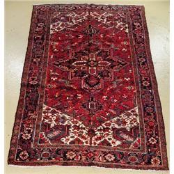 A Semi Antique Persian Heriz Wool Rug.