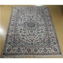 A Persian Nain Silk and Wool Rug.