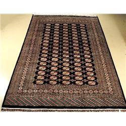 A Pakistani Bokhara Wool Rug.