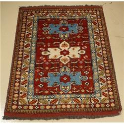 A Persian Khorasan Wool Rug with Animal Motif.
