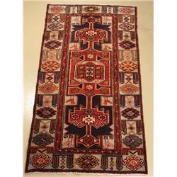 A Persian Bakhtiari Wool Rug.