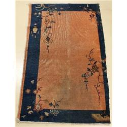 An Antique Chinese Wool Rug.