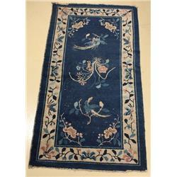 An Antique Chinese Peking Wool Rug.