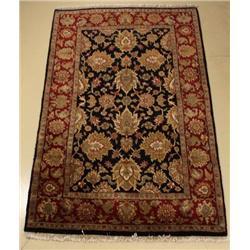 An Indo Persian Tabriz Wool Rug.
