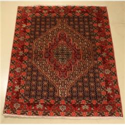 A Persian Senneh Bidjar Wool Rug.