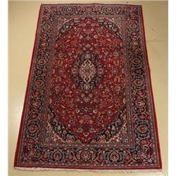 A Persian Kashan Wool Rug.