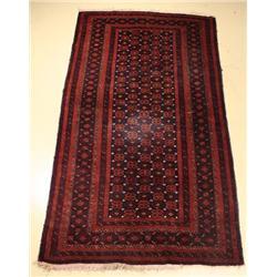 A Semi Antique Persian Baluch Wool Rug.