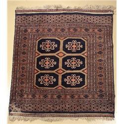An Old Pakistani Bokhara Wool Rug.