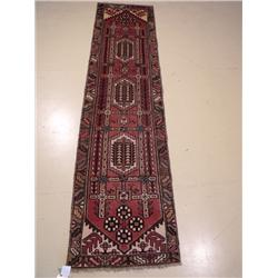 A Persian Karajeh Wool Runner.