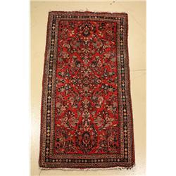 A 1920's Persian Sarouk Wool Rug.