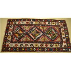 An Antique Caucasian Wool Rug.