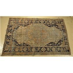 An Antique Persian Motosham Kashan Wool Rug.