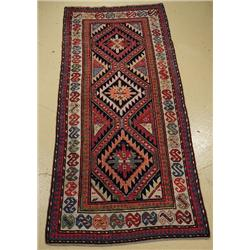 An Antique Geudge Caucasian Wool Rug.