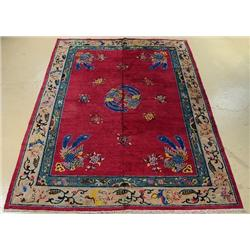 An Antique Chinese Peking Wool Rug.