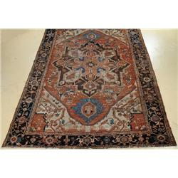 An Antique Persian Serapi Wool Rug.