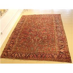 An Antique Persian Heriz Wool Rug.