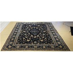 A Persian Kurk Kashan Wool Rug.
