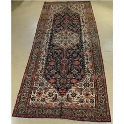 An Antique Persian Bibikabad Wool Rug.
